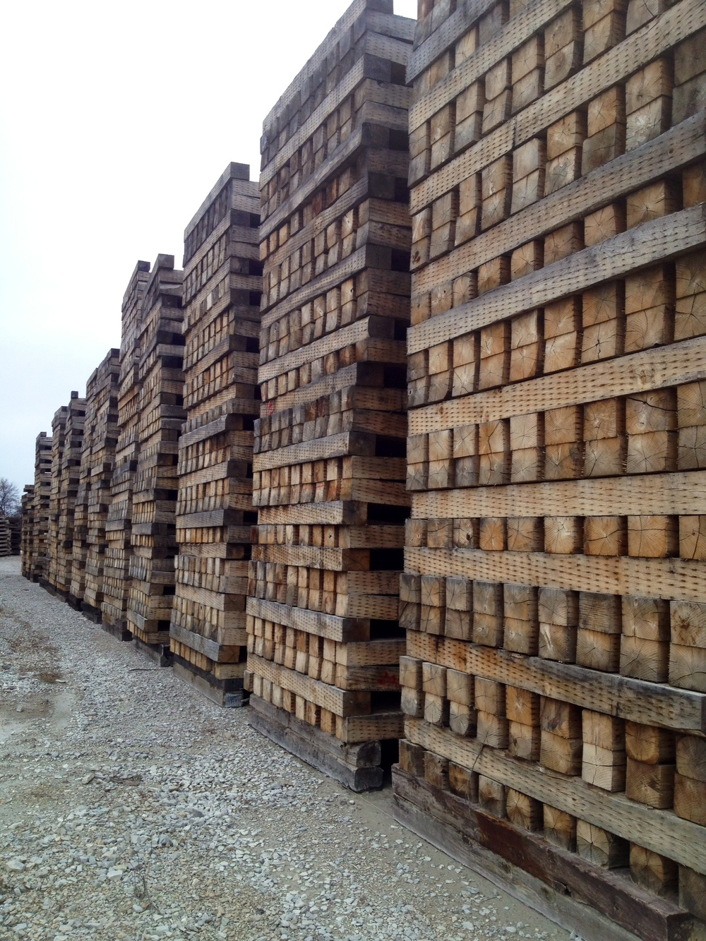 stacks of untreated timbers from Rail Yard Studios