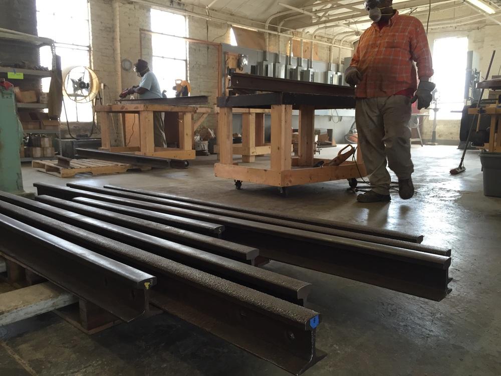 Railroaders at work in the shop at Rail Yard Studios