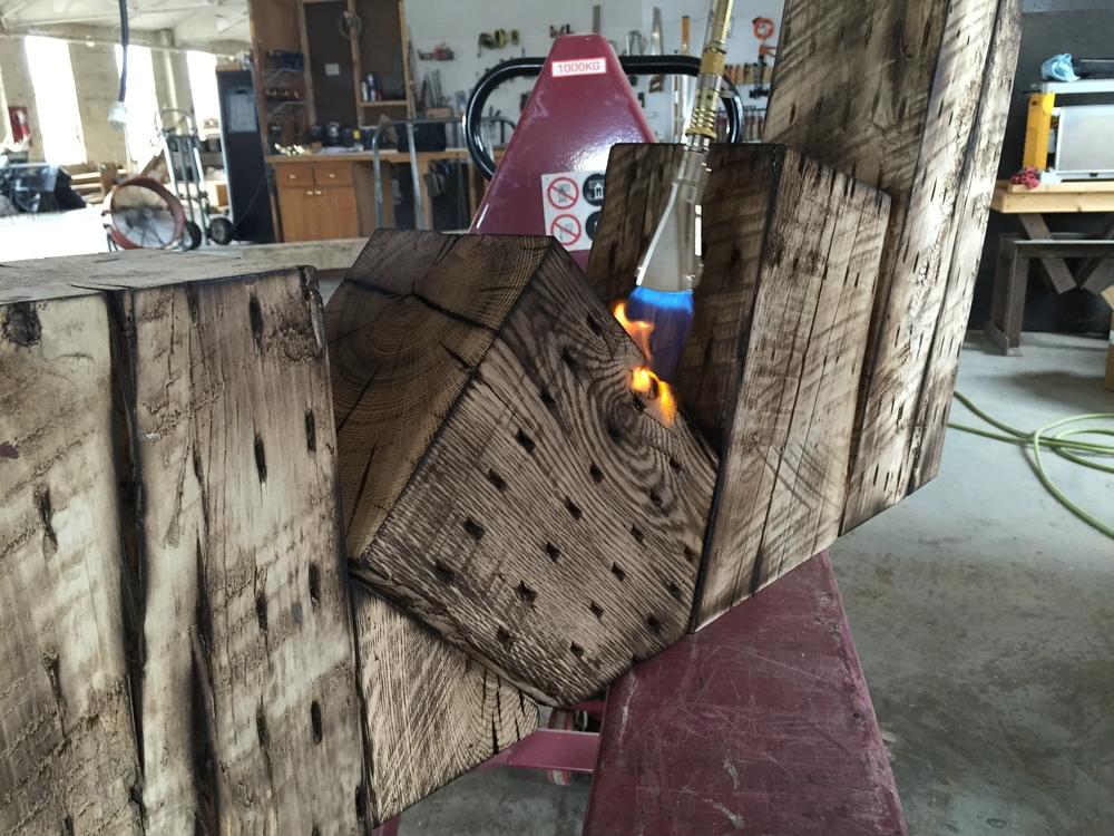 Charred wood finishing technique at Rail Yard Studios