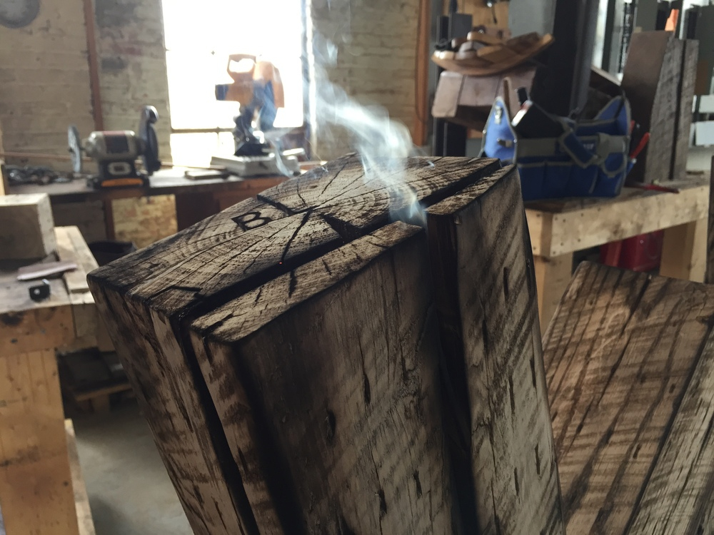Smoldering timber at Rail Yard Studios