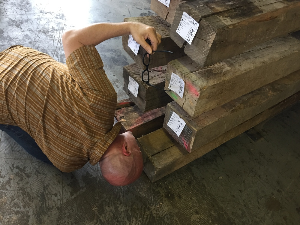 Robert Hendrick putting an eye on elm, oak and maple timbers at Rail Yard Studios