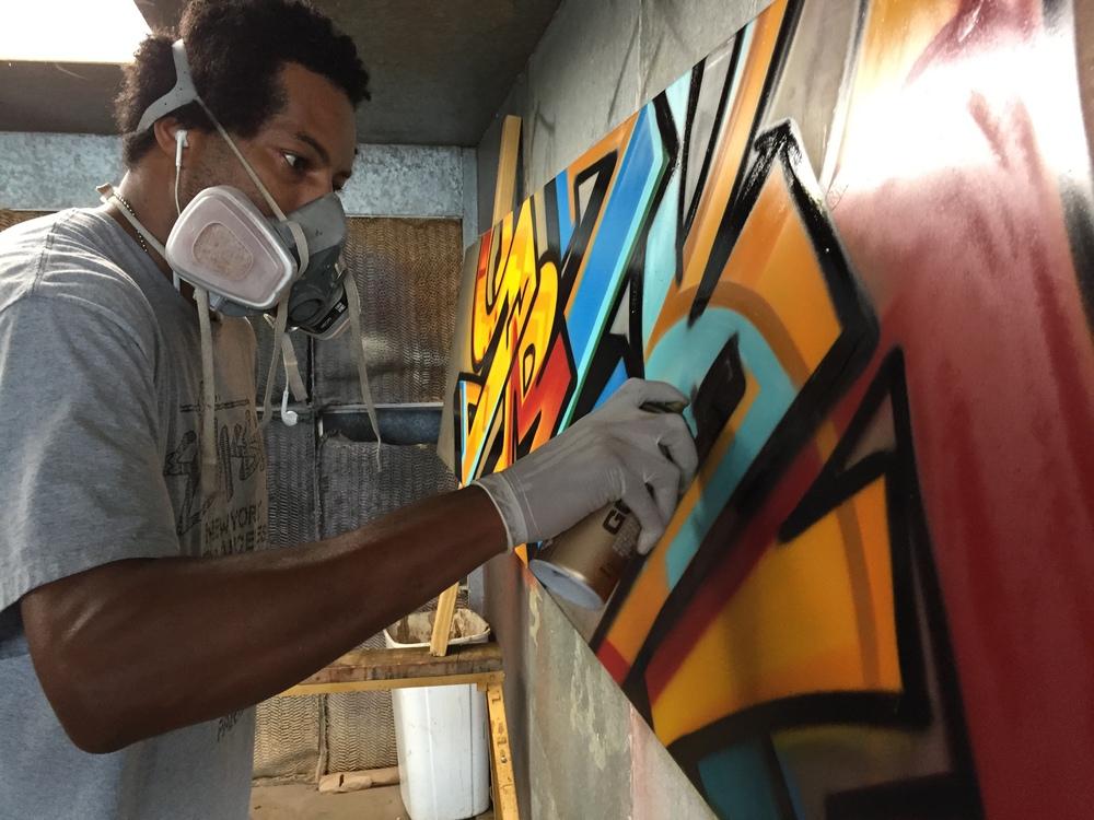 Troy Duff working a graffiti table top at Rail Yard Studios