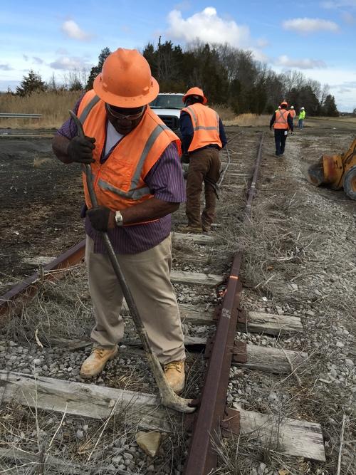Railroad crew pulling track