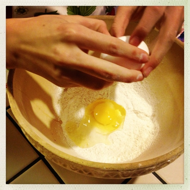 Her hands, empowered and strong, gentle and swift in cracking the eggs.