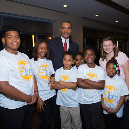 Ukee Washington, Co-anchor of CBS's Eyewitness News, Assistant Children's Program Director, Brooke Julian, and some of the Fellowship House children and teens.