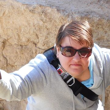 """Ranger was rejected from seven MFA programs, so she decided to become a Protestant minister. She was most recently published on Autostraddle as the co-author of the fiction piece """"Handcrafted Bamboo."""" In addition to writing, Ranger enjoys knitting, baking, and (of course) adventuring. Ranger lives in the New York Capital Region with her kitten, Wesley Wyndam-Pryce."""