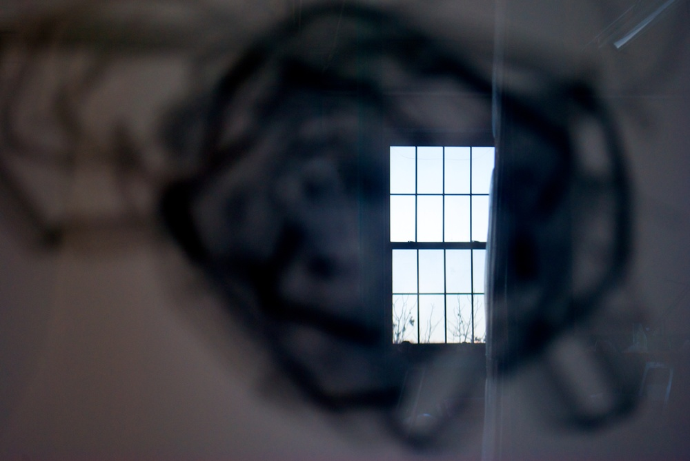 Stefana McClure's studio as reflected in a glass frame.