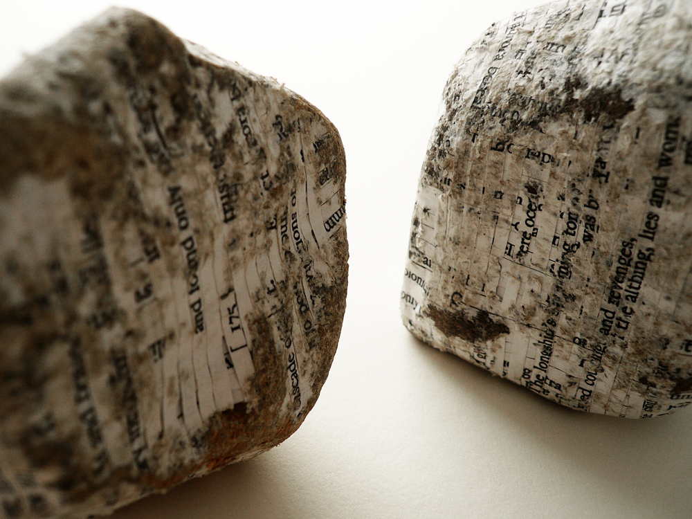 North (a Poem by Seamus Heaney), detail , cut paper, stones, two stones (Left 9 x 9 x 5 cms, Right 10 x 7 x 4 cms)