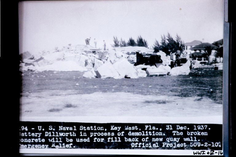 1937 - Battery Dillworth being destroyed to be used for fill in new Quay wall. The photo clearly shows that Australian Pines were present at Fort Taylor.