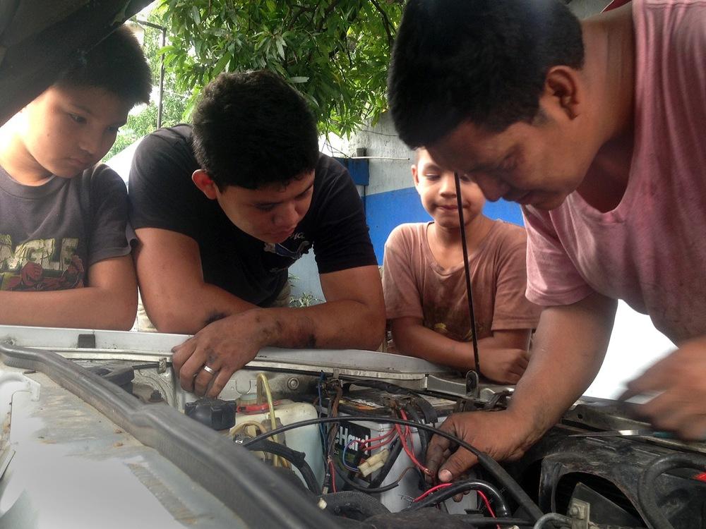 7 Dog mechanic-guatemala-gas-station.jpeg