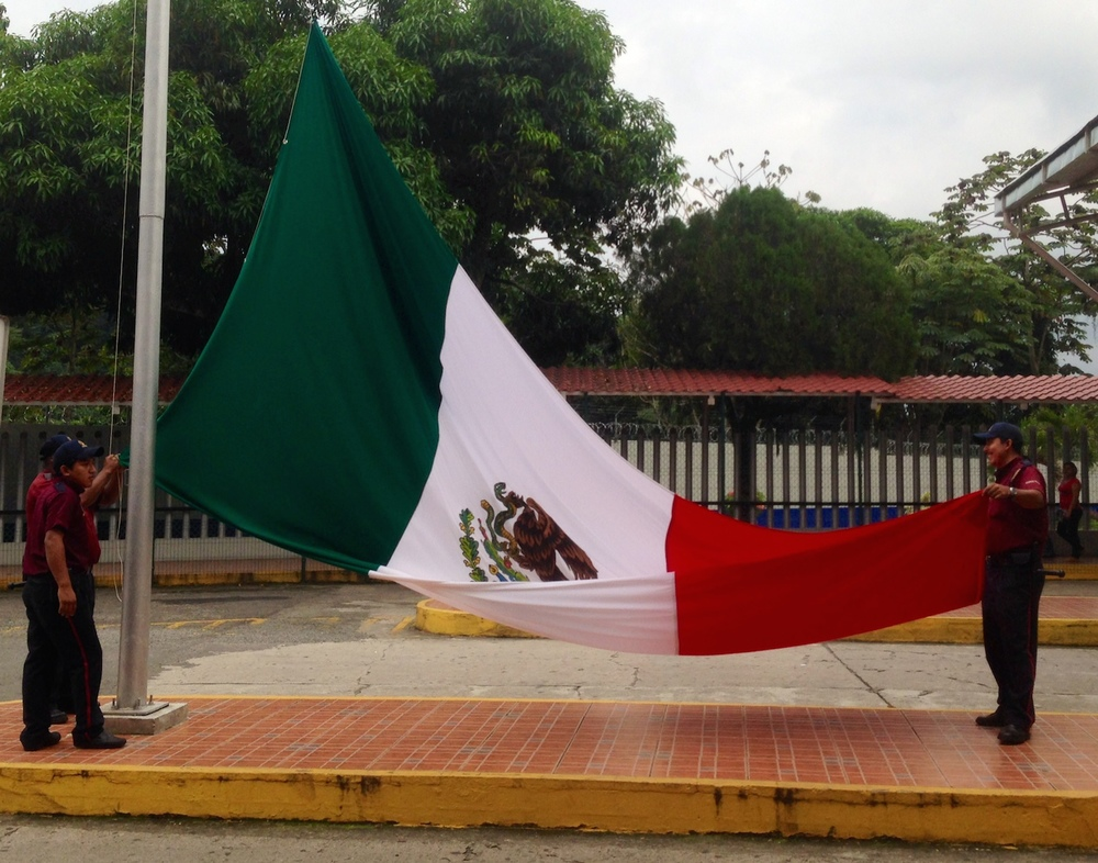 Closing the Mexican chapter of our trip, the Mexican flag is lowered as we cross the border and pass into Guatemala
