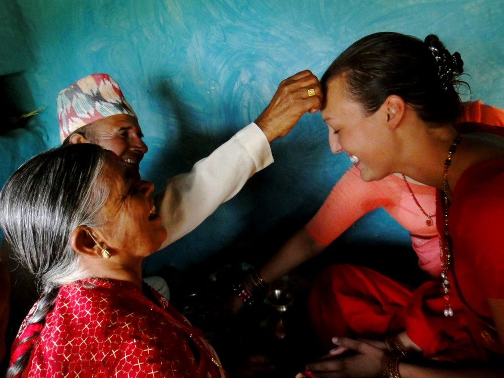 Getting a tikka blessing from her nepali grandparent