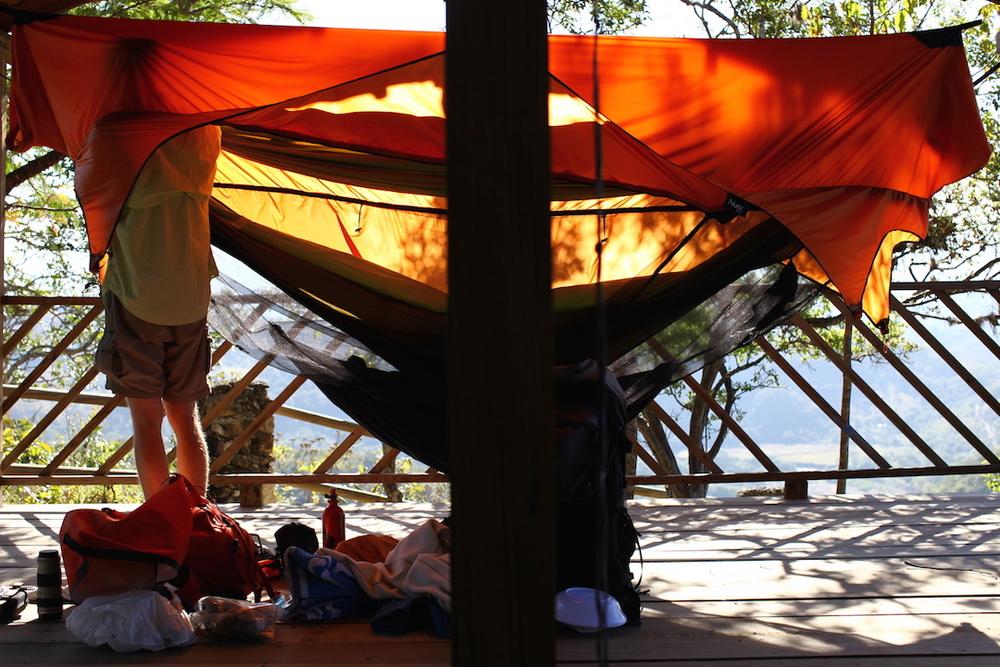 Richard setting up Hambunks in his Burnt Orange Nubé Hammock Shelter