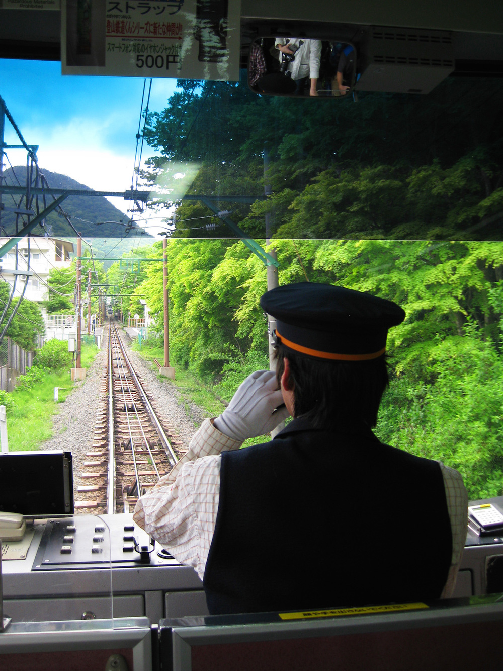 Another smartly dressed rail conductor, making our way to Souzan Station on the way to Owakudane Station where they boil the black lucky eggs (eggs set in boiling sulfur-water pools) along the Hakone loop. They take extreme pride in their sharply made outfits with special watches, gloves, and hats.