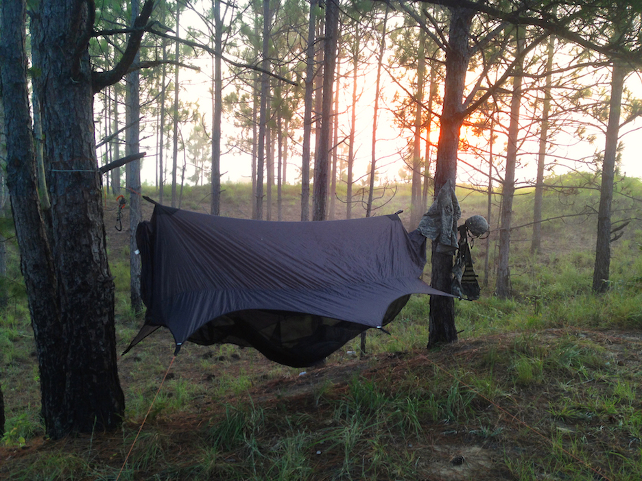 """Just got back from training at camp shelby, MS. The 13 Fox platoon and I spent 12 days and nights in the field and my Nubé hammock system was outstanding. It rained 3 of those 12 days and none of my gear was wet when I returned that night to bed down. This was on the 9th day in the field while I was rinsing my head with my canteen and shaving my face as best as I could haha. Very foggy morning with the sun barely out of the sky. It was extremely hot, but luckily having the Nubé allowed more air to flow within the shelter so it cooled off late at night. I still went to bed sweating just from the extreme heat, but about an hour after that the temperature dropped. With all that being said, I am very pleased with my hammock and shelter and will continue to use my system. Thank you for the shelter system and I hope you have a great day! God Bless!"" ~Photo by Casey Ferguson"