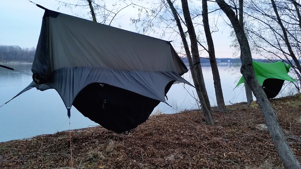 Spruce Tip and Steel Grey Nubé Hammock Shelters on river bank