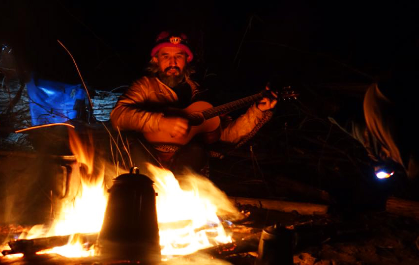 John Ruskey singing by the fire - Photo by Layne Logue