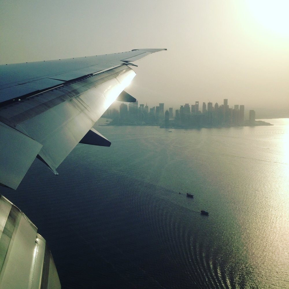View of Doha, Qatar upon approach to Hamad International Airport, the first of many stops before reaching Brunei, on the island of Borneo. Photo by Ariel Miranda.