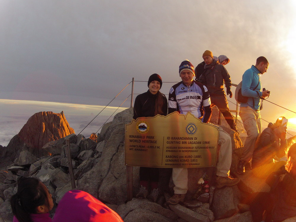 Ariel and her team beat the sun and enjoy the sunrise at Low's Peak- 4095 meters, the summit of Mt. Kinabalu, the highest mountain on the island of Borneo and a UNESCO World Heritage site. Photo by Ariel Miranda.