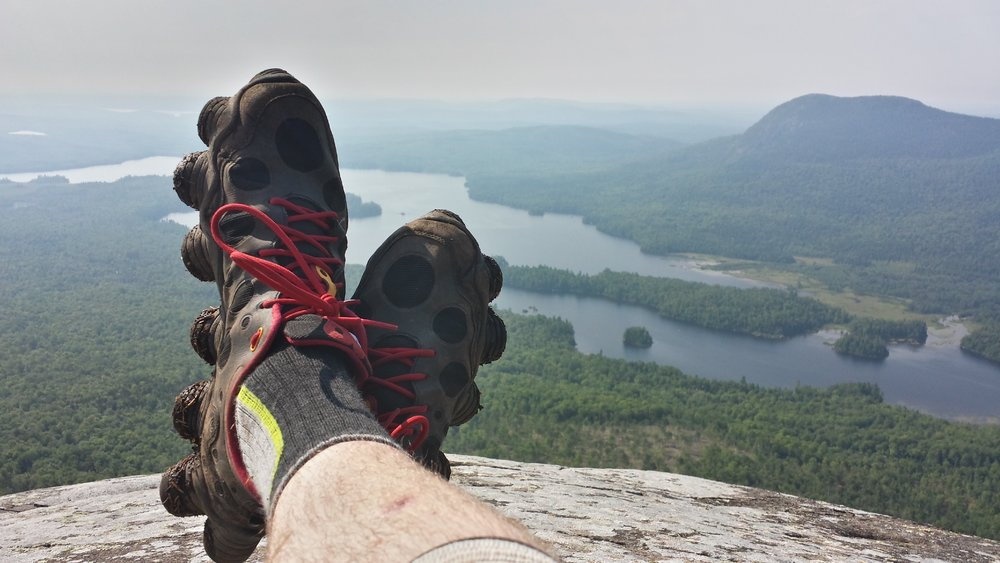 """Overlooking the picturesque temperate forests of Maine- Chad Haynes lounges in his Reebok ATV 19's, the shoes responsible for his trail-name """"Octo""""."""