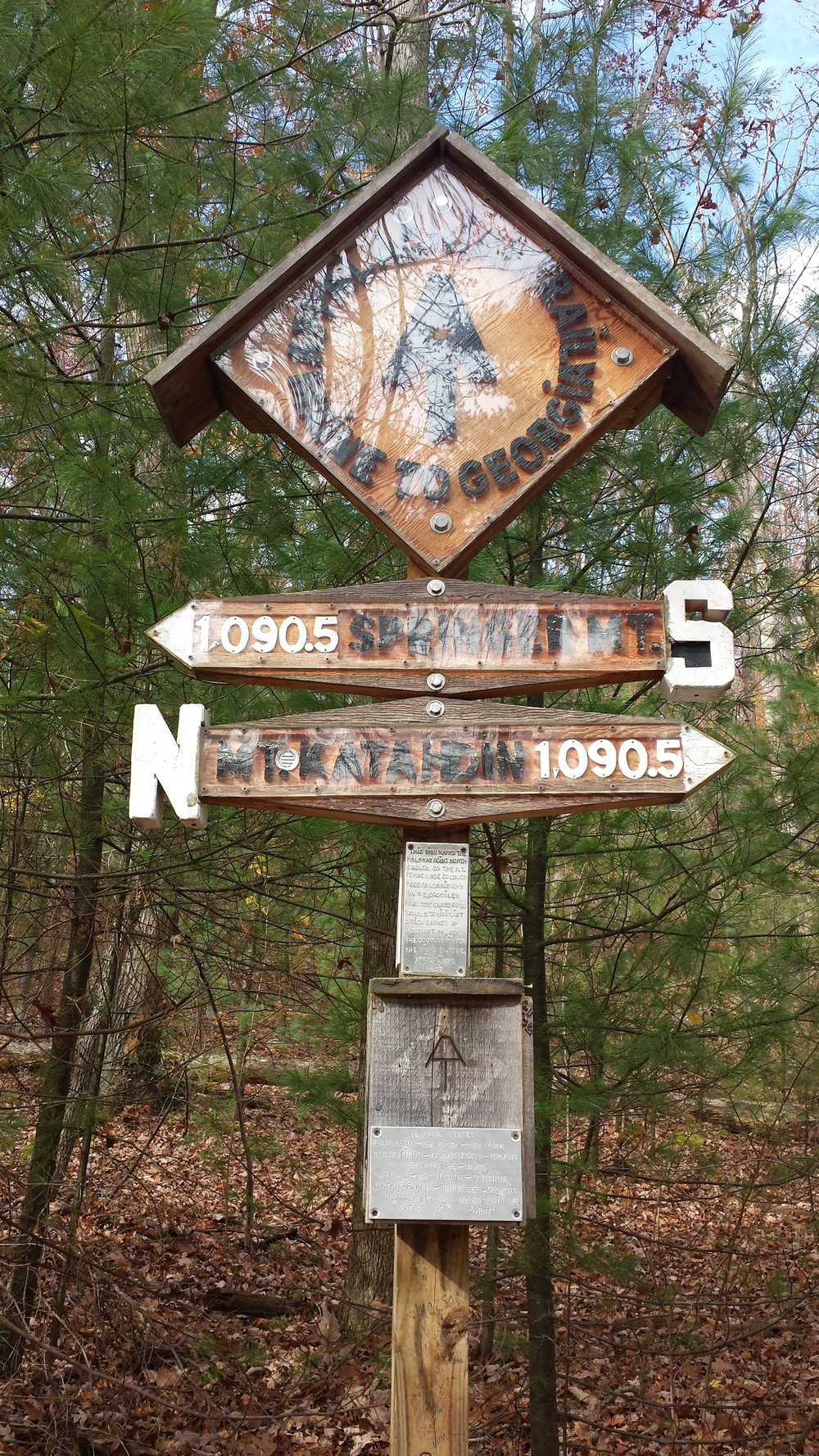 A sign showing the exact halfway point for the Appalachian Trail at Pine Grove Furnace State Park in Pennsylvania.