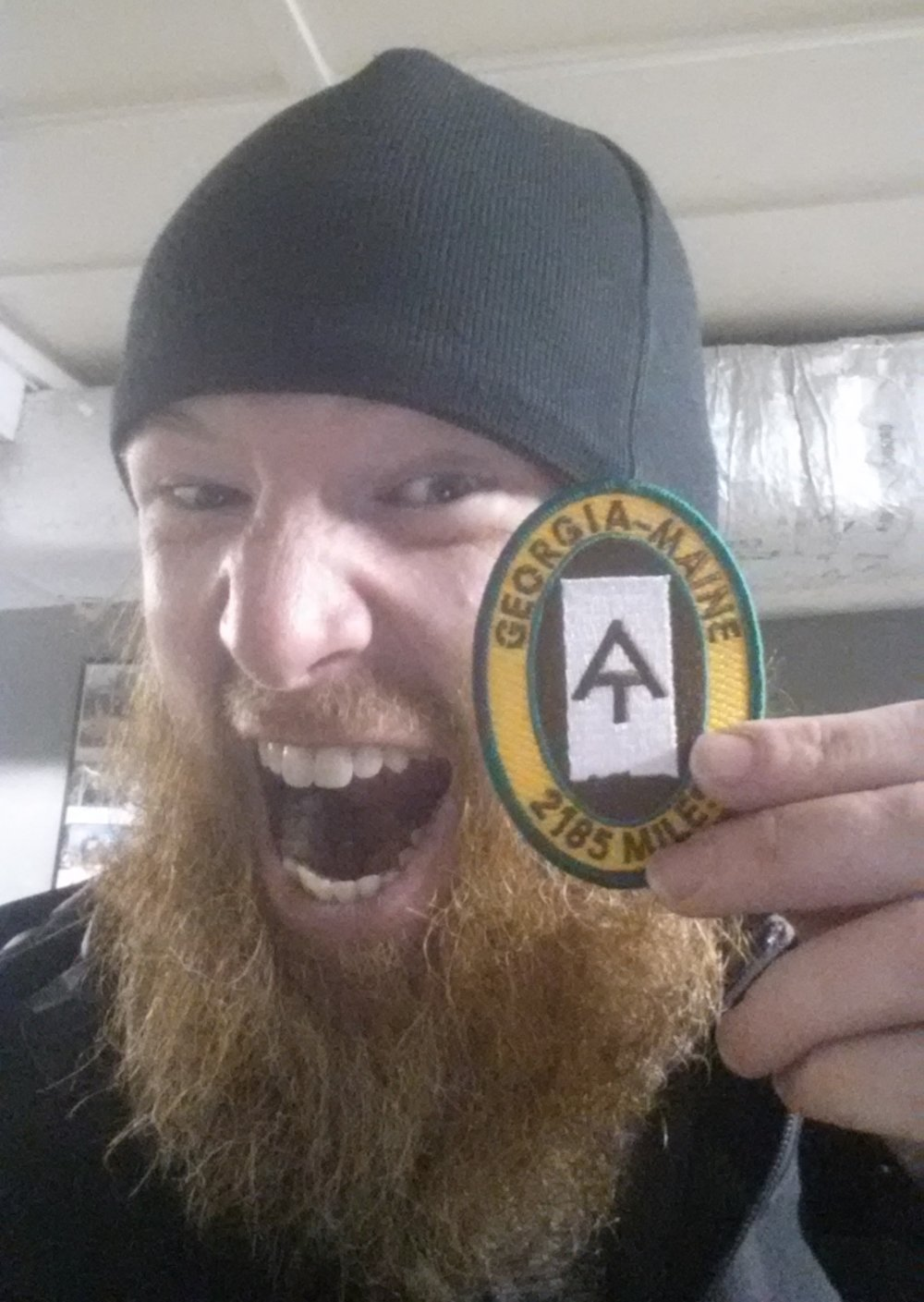 """After through-hiking 2,185 miles along the rugged Appalachian Trail of the East Coast, Chad """"Octo"""" Haynes makes it to Georgia and earns his patch and a place in the trail book."""