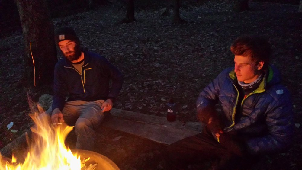 "Chad ""Octo"" Haynes and his trail friends ""Dirty"" and ""Socrates"" around the fire on their last night completing the Appalachian Trail."