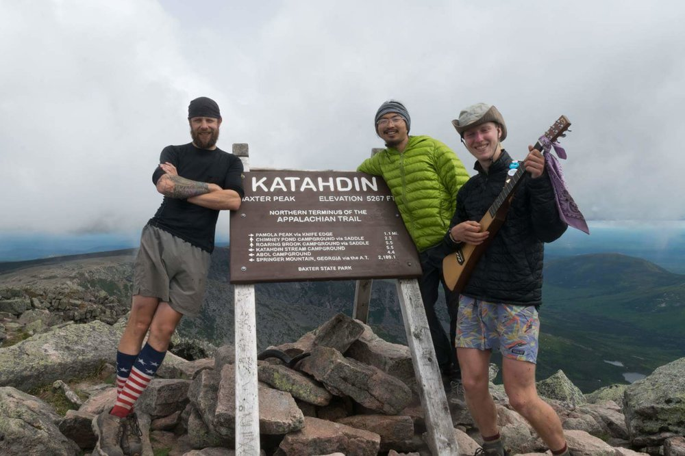 "On June 12, 2016, after two years and four sections, Erik Barstow aka ""Guardian of the Vortex"", finishes his Appalachian Trail journey at Baxter Peak, Mount Katahdin- Maine. Pictured with him are through-hikers, trail-names Yoda and Indiana Jones."
