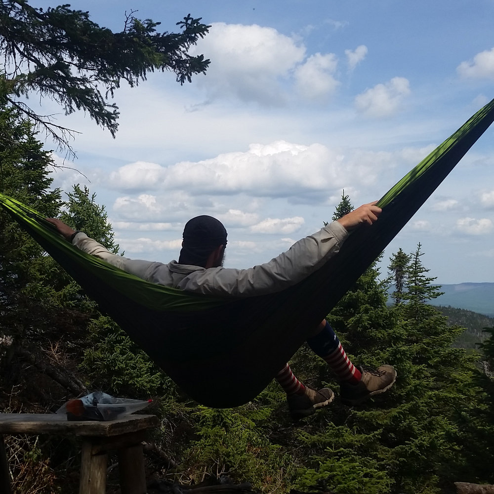 Erik Barstow enjoys the view near the Appalachian Trail on Bemis Mountain, North of Andover, Maine.