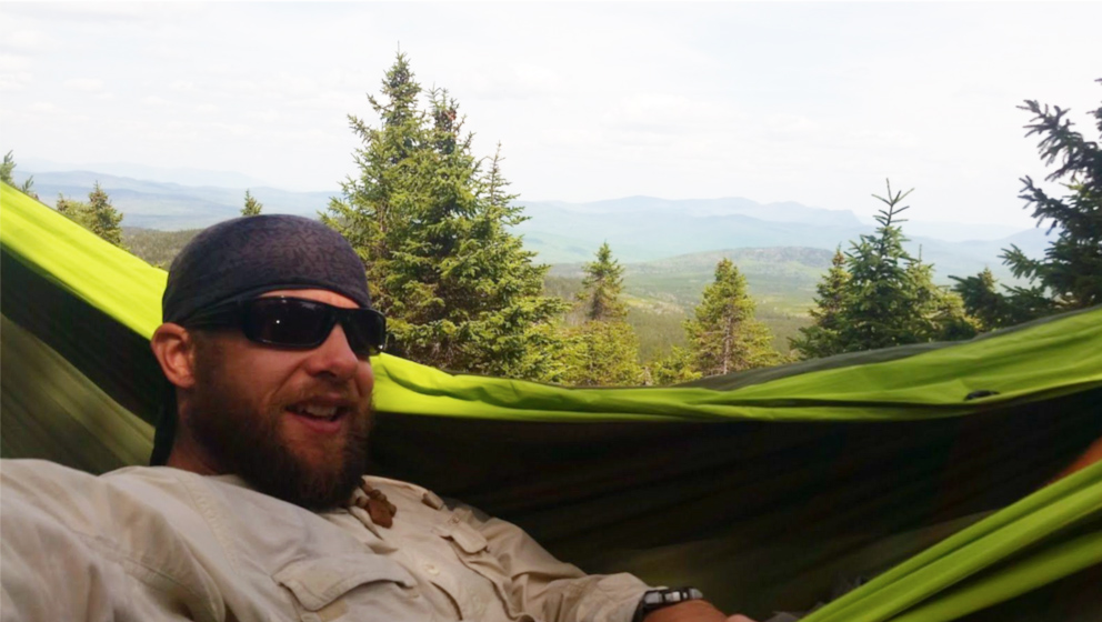 Former marine-turned photographer Erik Barstow enjoys the view from his Pares hammock.