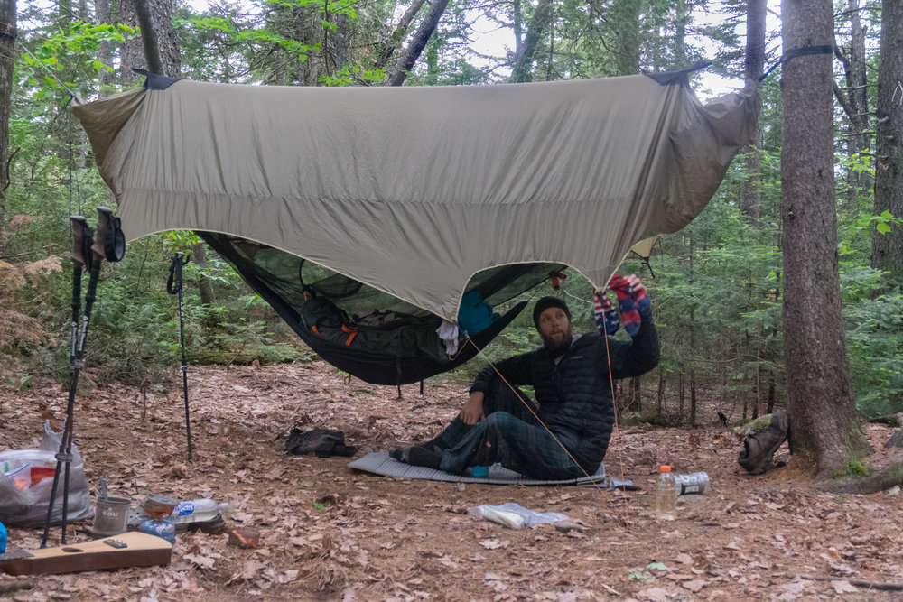 After a long days' hike in the 100-Mile Wilderness of Maine, photographer Erik Barstow enjoys relaxing in his Nubé Stratos. Photo by Jon Constable.