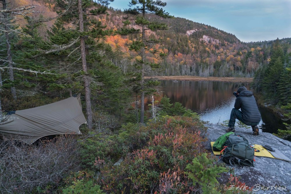 Photographer Erik Barstow snaps a few shots of the stunning fall scenery around Gentian Pond off of the Appalachian Trail.