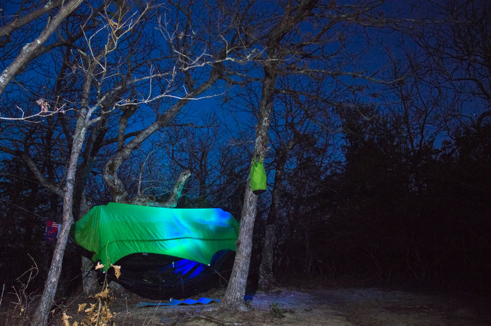 Photographer Erik Barstow enjoys the cool nights on the Appalachian Trail from the comfort of his Illuminated Nubé hammock camping system.