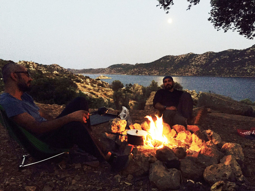 With a spectacular sunset in the backdrop, Soner and his brother, Bekir, enjoy bonding over the first bonfire of their trek along the ancient path of Lycian Way.