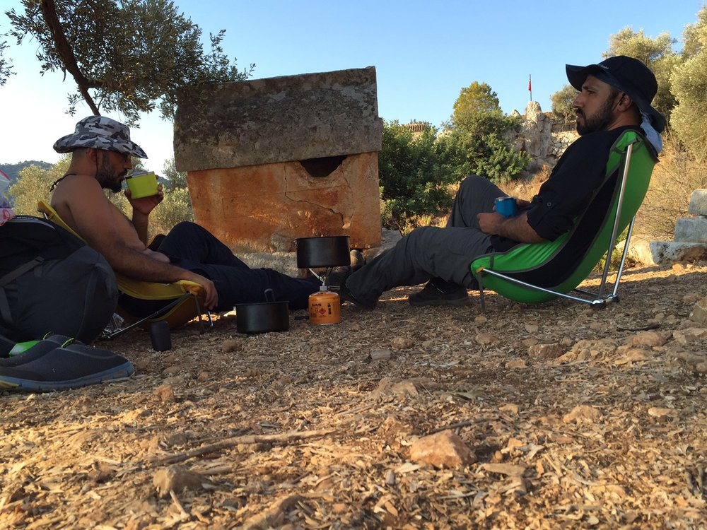 After the end of a long first day, Soner and Bekir share a meal amongst the ancient Lycian tombs along the footpath.