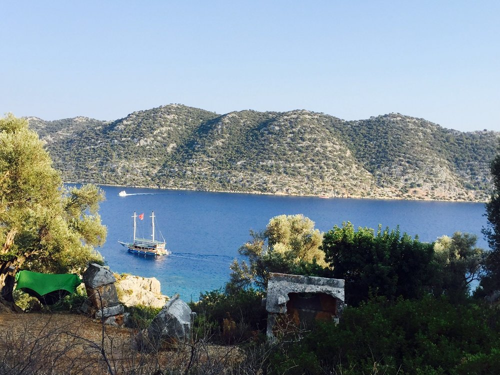 A boat traverses a river along Lycian Way, an ancient footpath built by the Lycian during the Bronze Age.