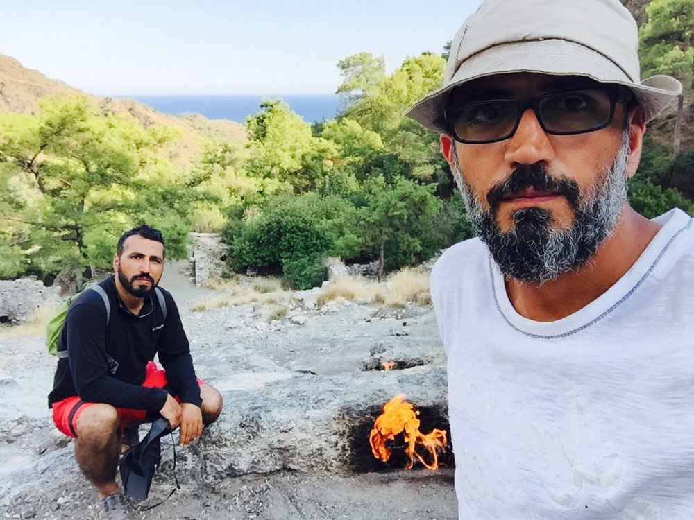 The Kubat brothers enjoy the fires of Yanartaş on Mount Chimaera along the Lycian Way in Turkey.