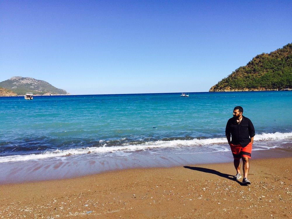 SMrAdventurer Soner Kubat on the beach at Likya Yolu,Turkey.
