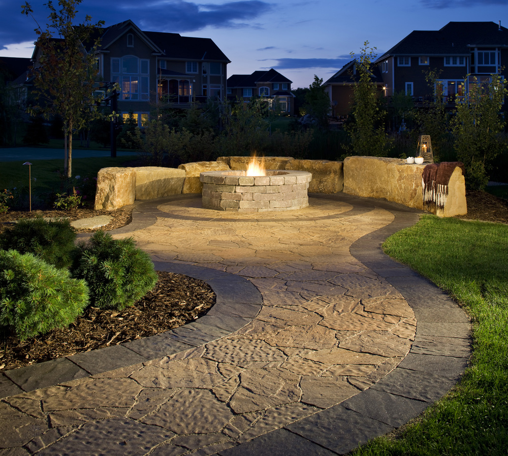 Belgard fire pit. Native stone benches. Mega Arbel patio
