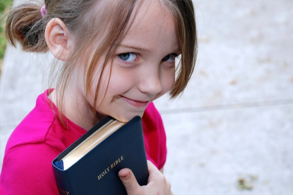 little-girl-with-bible-outside-church.jpg