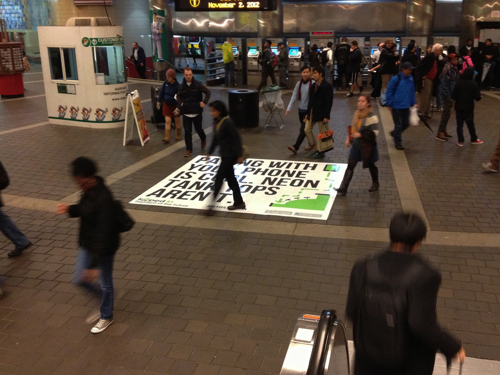 Floor Advertisement at the Harvard MBTA Station