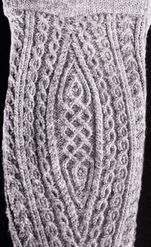 I love the patterning in the calf gusset of this traditional twisted-stich stocking.