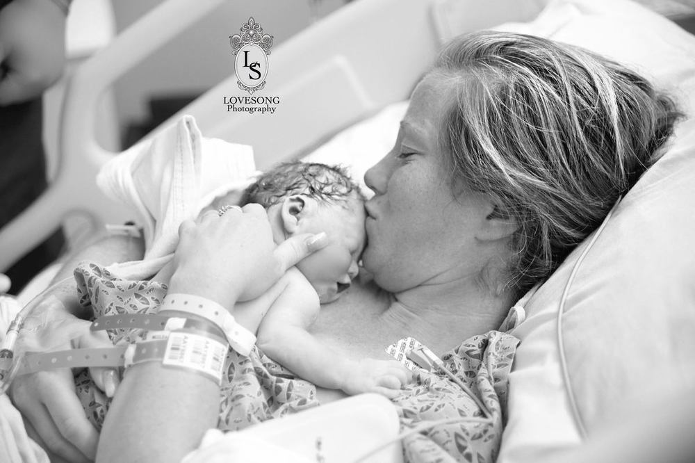Mother Emily and baby Monroe in a beautiful embrace captured by Lindsey Natzic-Villatoro.
