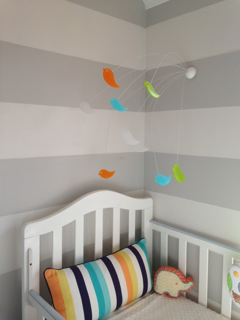 Wall-mounted crib mobile: out of reach