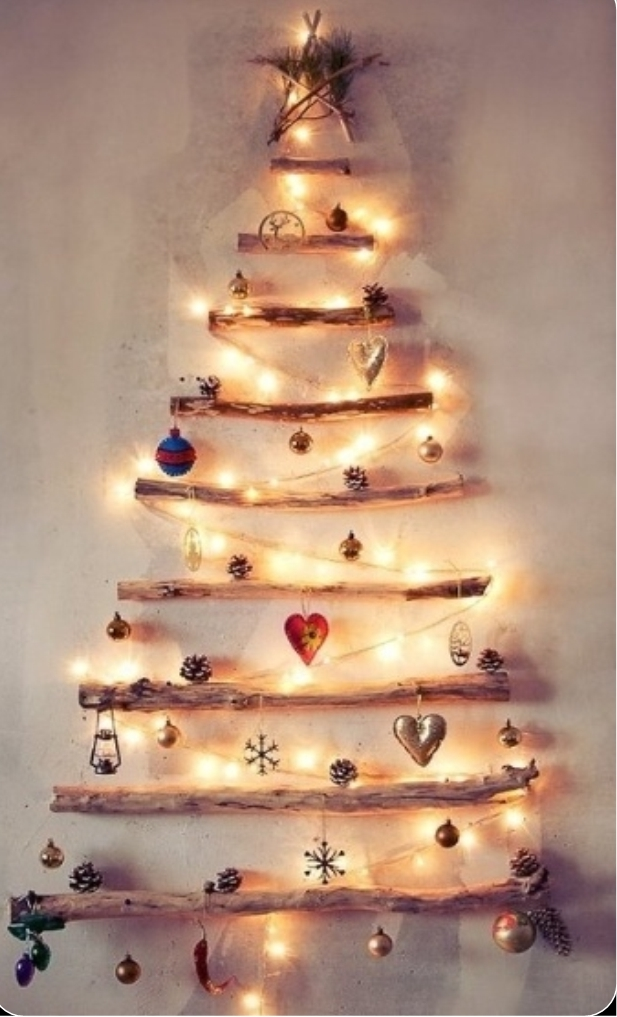 Repurpose wood to make a wall hanging Christmas tree!