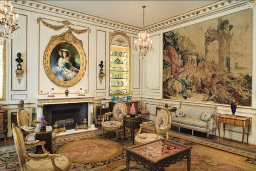 French-inspired interior design: a first glance at home decor utilizing art, tapestry, and shelves