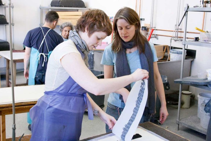 Book & Paper alumna, Kaitlin Kostus (left) works on one of Sheroanawë Hakihiiwë's edition images.
