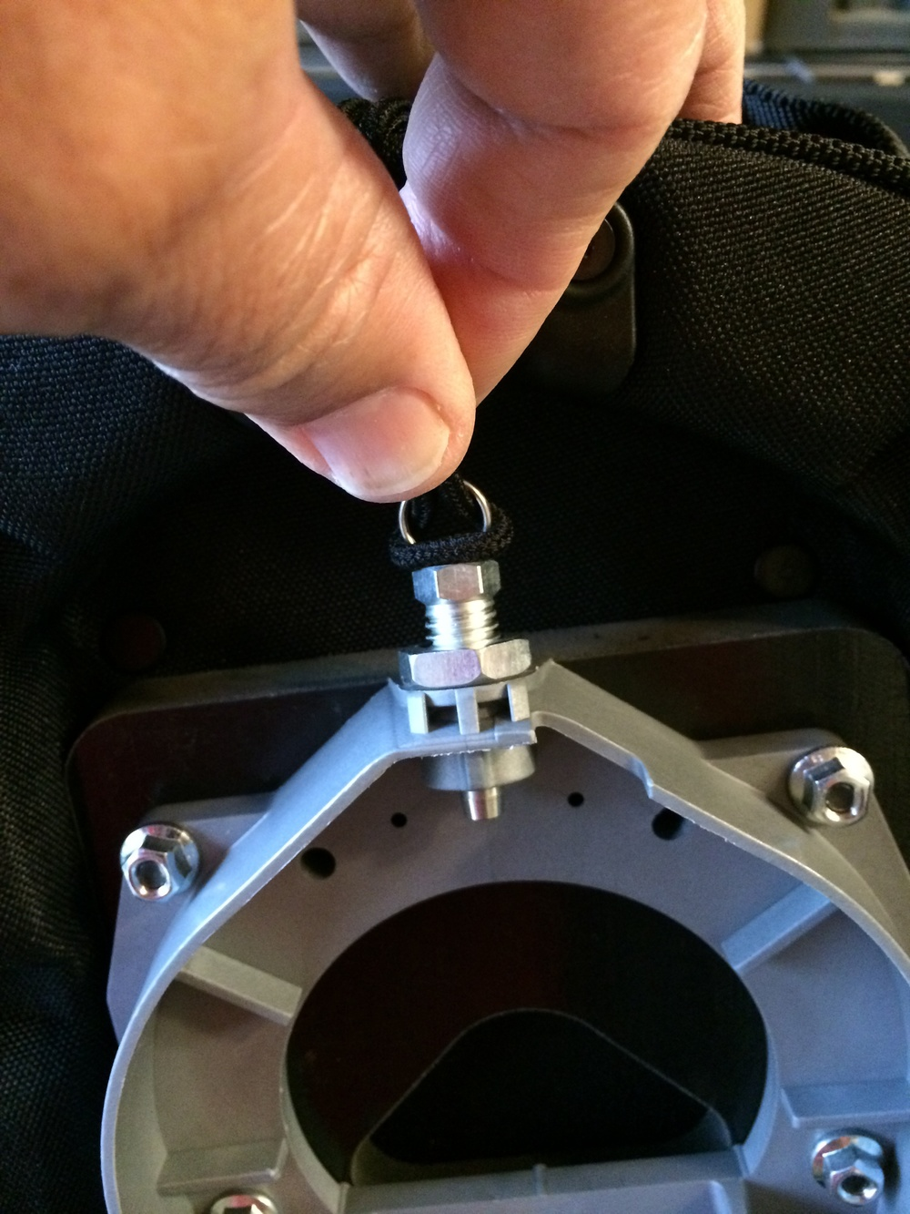 Here's the mating plate that goes on the bag. The pin secures the bag in place and it does not need to be pulled in order to insert the tank bag base onto the tank base. It does need to be pulled to remove the tank bag from the base.