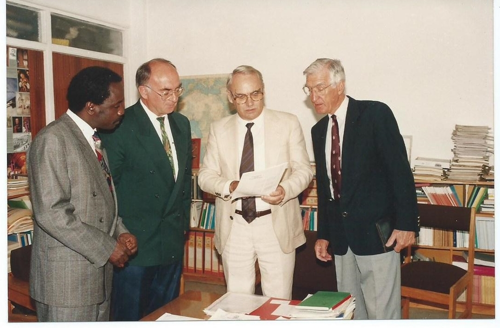 German Academic Exchange Services (DAAD) Regional Representative, Eastern Africa, Nairobi, Donating Funds for the MSc and PhD Program of ABI-GIDE in (1994).  From Left: Dr. Alfred Latigo, Chair ABI-GIDE MSc/PhD Academic Panel; Prof. Dr. Paul Muller (Late), Chair Board of Directors, ABI-GIDE; Regional Representative, German Academic Exchange Services (DAAD), Nairobi;  Dr. Paul Capstick, Deputy Executive Director, ABI-GIDE (1994)