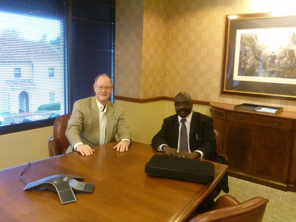 Kurt Wall, Board Director with Alfred Latigo, President after a Board Meeting with other Directors via Video Conferencing